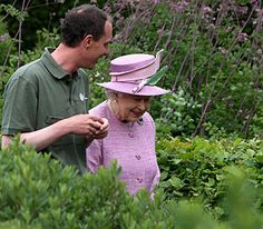 The Queen is given a tour of 'The Queen Mother Memorial Garden' during a visit to Edinburgh's Royal Botanic Garden, 12 July 2010