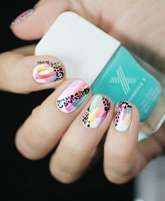 Watercolor and leopard print nail art is a perfect combo for a fun design.