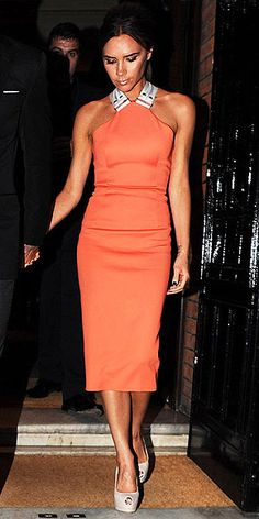 Dare to try this popular colour of summer - orange? Victoria Beckham certainly kicked butt in this elegant orange halter ensemble and peep-toe platforms.