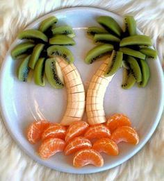 Banana and kiwi palm trees resting on oranges