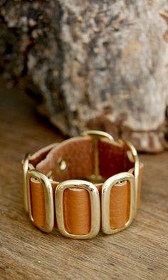(http://www.shopconversationpieces.com/belted-buckles-leather-bracelet-brown/)