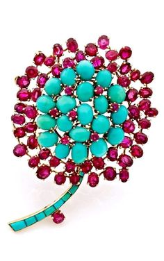 A TURQUOISE, RUBY AND 18K YELLOW GOLD CLIP, BY BOUCHERON, CIRCA 1980