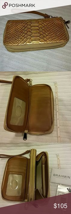 """NWT Brahmin Zoe dual zip Wristlet Wallet Brand new w tags, warranty.  Zoe Brahmin wallet in Fire Opal.  Seville leather.  Beautiful shine.  Detachable wristlet strap.  10 card slots plus ID slot.  4 bill slots.  One interior zip coin holder.  Large enough for most phones, too. 7""""length by 3.5"""" height by 1.25"""" thickness Beautiful wallet! No trades please....cleaning out my closet! Brahmin Bags Wallets"""