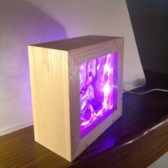 Multicolor led lamp in natural oak with glass brick by Engardina
