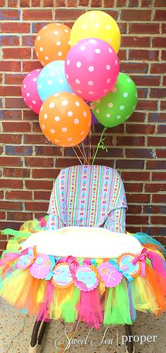Candy Themed Birthday Party Ideas | 1st Birthday High Chair Decorations | Colorful High Chair Decorations for Birthday | Polka Dot Balloons | Tutu High Chair