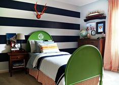 Cute mix of colors and ideas for a boy's room - could stick sith navy check curtains/bed skirt and go with orange and green for other features
