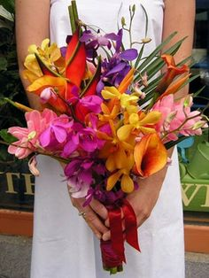 Hand Tied Wedding Bouquet Of Bright Tropical Florals: Purple, Fuchsia + Orange Orchids, Pink Curcuma, Flame Orange Calla Lilies, Emerald Green Palm