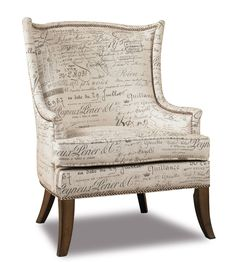 Bewitching in style this chair is crafted with Document Fossil Fabric.