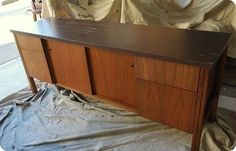 Would love to find an old credenze like this to 'redo' and make a tv entertainment center out of with paint etc. in my basement.  Would be PERfect with changing out a sliding door or 2 with glass so the remotes work.  And wouldn't it be so sturdy!!