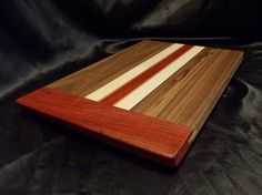 Hey, I found this really awesome Etsy listing at https://www.etsy.com/listing/68407467/walnut-and-padouk-cutting-board