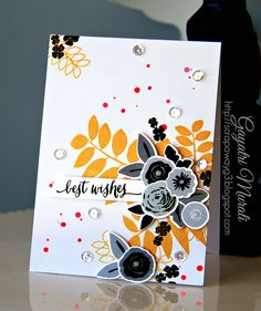 LOVE this color pallette.  Black and grey flowers and orange leaves!?  what?  So cool!