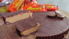 If you can't get enough of Reese's peanut butter cups, then we've found the recipe you've been dreaming of. Instead of buying and unwrapping a bunch of these little treats for dessert, why not make a giant one that you can cut like a cake and serve to everyone after dinner? Thanks to Cupcake Addiction, this giant peanut butter cup dream is now a reality: Here are the ingredient proportions used in the video: 2 2/3 cups powdered sugar, sifted 2 2/3 cups smooth peanut ...