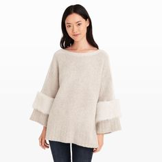 M.Patmos is designer Marcia Patmos's namesake line of luxurious, sculptural ready-to-wear pieces. With winter close on the horizon, rich, cozy layers like this lush poncho move closer and closer to the top of our lists. Accented with unique shearling arm panels, this layer is warm and versatile enough to wear both indoors and out. Cashmere/silk/elastane body; lamb shearling arm panels Oversized fit Boatneck poncho; ribbed knit detailing along n
