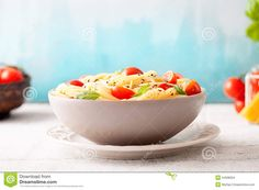 Italian cuisine. Pasta with olive oil, garlic, basil and tomatoes ...