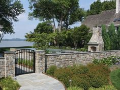 This #stone #wall by 2012 LCA winner Walnut Hill Landscape Company conceals the #driveway from the #pool area. #outdoor #design #landscaping
