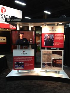 Dan and the Team of Lambert Tile and Stone on display in Custom Building Products booth promoting Fusion Pro Grout at Surfaces 2013 in Las Vegas.