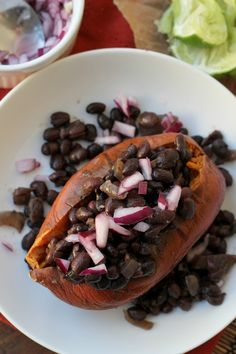 The ultimate set it and forget it meal, this slow cooker black bean ragout is hearty and delicious, especially served over roasted sweet potatoes!