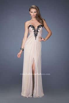 La Femme Prom - 19819 Strapless net jersey dress with a plunging neckline and sheer inset. Dress is gathered toward the center of the waist and has a middle slit. Neckline is adorned with jeweled black lace. Back zipper closure.