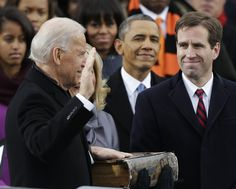 President Barack Obama, center and Beau Biden, Attorney of Delaware, right, watch as his father Joe Biden is sworn in at the ceremonial swearing-in at the U.S. Capitol during the 57th Presidential Ina