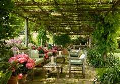 A soothing backyard retreat under a pergola. Portofino, Italy. http://atcasa.corriere.it/gallery/Tendenze/Libri/2012/05/29/case-portofino/case-portofino_gallery_8.shtml#