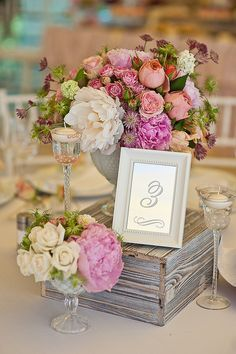 Floating candles in wine glasses, wooden box, florals and table number. Love the different levels...adds interest!  #tablescape, #tablenumbers  #centerpiece