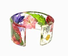 Meadow Floral Cuff Bracelet. Bracelet made of real leafs & flowers! Ultra clear jewelry grade resin! VOCs free! All my unique bracelets are handcrafted, from the moment they are visualized in my mind, to final polish! Color: Clear Size: Medium, inner diameter 2 1/2, inner circumference