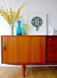 Love retro teak furniture in an updated modern setting. You can usually find these for a good price on kijiji.