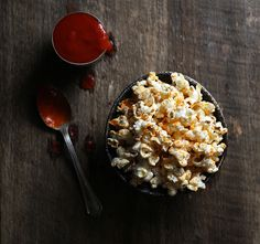 Sriracha-Coconut Popcorn with Smoked Sea Salt. Make with organic popcorn.