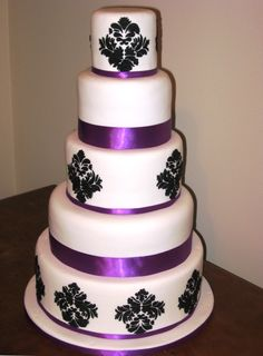 Google Image Result for http://simmer.co.nz/Wedding%2520Cakes/five%2520tier%2520white%2520wedding%2520cake%2520with%2520purple%2520ribbon.jp...