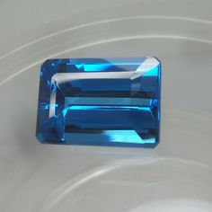 SWISS BLUE TOPAZ 7 MM SQUARE CUT  AAA ALL NATURAL