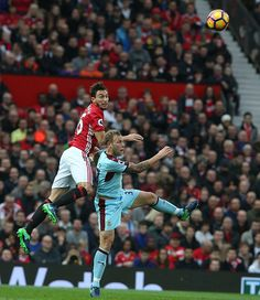 Matteo Darmian of Manchester United in action with Scott Arfield of Burnley during the Premier League match between Manchester United and Burnley at...