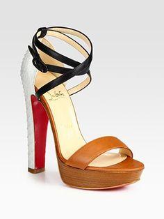 Christian Loboutin Leather and Python Colorblock Platform Sandals; Saks Fifth Avenue retails for 1282.72$