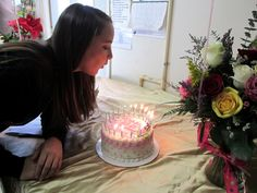 Ashley blowing out her birthday candles