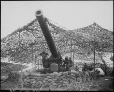 240mm howitzer of Battery B, 697th Field Artillery Battalion, just before firing into German held territory, Mignano area, Italy, 30 January 1944.