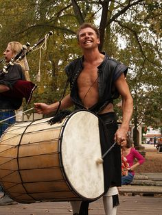 Plantersville Texas Renaissance Festival Music band Tartanic playing drums and bagpipese