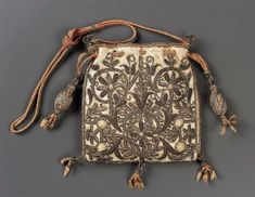Drawstring bag, English 1575-1650.  Silk embroidered with metallic threads, metal purl, wire and spangles.