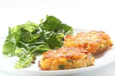 Classic Crab Cakes With Mayonnaise and Creole Seasonings: Pan-fried crab cakes with green onion and mayonnaise.