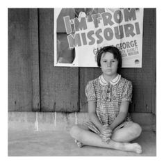 """Flood Refugee – 1939. Posters - """"Advertisement for current movie in town. Westley, California. The child is a flood refugee of March 1939 from southeast Missouri,"""" Dorothea Lange, photographer, April 1939. Movie: """"I'm from Missouri."""" (https://twitter.com/HawCreekShop/status/534185195444785152) (http://haw-creek.com/shop/sold-18/)"""