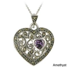 This chic heart locket necklace showcases a filigree designed heart shape. This jewelry features marcasite stones with a heart-shaped gemstone on this highly polished pendant.