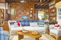 """Wet swimsuits? Bring 'em on! Mary scoured secondhand shops for weather-resistant wovens—rattan, wicker, and bamboo—that can take a beating indoors or out. """"We live a lot of life in this house,"""" she says. """"No one wants to spend time worrying about the upholstery."""" Similarly, indoor/outdoor rugs (seen throughout the home) stand up to flip-flop traffic—and errant ice cream scoops. """"Our rugs have passed the family reunion test,"""" Mary says. """"Once they've withstood 16 sets of feet, knocked-over…"""