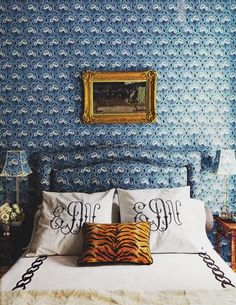 Ellen Niven's guest bedroom in Long Island home - padded walls, headboard and shade covered in Le Manach's Belmoral by Pierre Frey :: tiger velvet against Leontine linens.