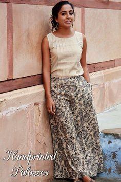 Hand block printed palazzos with beige top Dress Neck Designs, Blouse Designs, Kalamkari Skirts, Tops For Palazzo Pants, Fashion Pants, Fashion Dresses, Plazzo Pants, Simple Kurti Designs, Cropped Wide Leg Jeans