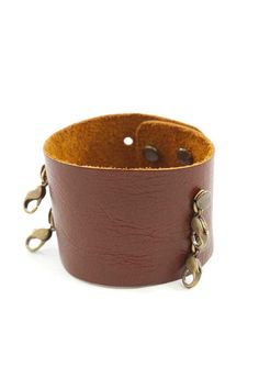 Made from the finest leathers, these classic cuffs go great with any style. A bit vintage, a bit rock & roll, a bit urban, but 100% Lenny & Eva. Cuffs can be worn with our interchangeable sentiments and pendants. All cuffs are made of genuine leather. Adjustable buttonhole closure. Fits wrists 6 inches - 8 inches.    Measures 1 5/8 inches wide.   Dark Chestnut Wide-Cuff by Lenny & Eva. Accessories - Jewelry - Bracelets Missouri
