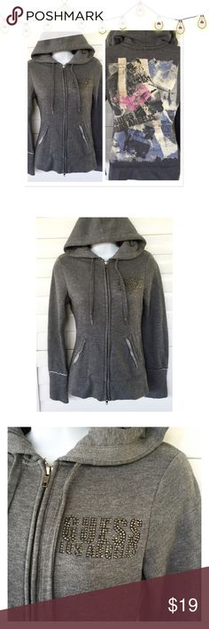 """⚫️ BOGO 1/2 OFF Guess Los Angeles Hooded Jacket  BOGO 1/2 OFF see Sale Post in my closet for more details   Embellished distressed hooded zip-up gray sweatshirt that's says """"Guess Los Angeles""""...2 front pockets Brand: Guess Size: Small (fits like an XS...see measurements) Measurements: length - 23.5""""; chest - 17"""" flat...no stretch to fabric Condition: preowned - good Guess Jackets & Coats"""