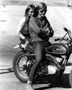 Robert Redford with Lauren Hutton on the back of his Yamaha