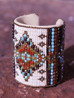 Chili Rose Cuff - Fun colors of red, rust, and sea foam turquoise in Czech glass and combined gemstones on a 3 inch brass moldable cuff. Lined with soft cream deerskin.