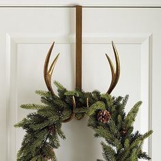 Find the perfect Christmas wreath and garland greenery for this holiday season! Shop garlands and wreaths at Ballard Designs today. Let your Christmas doors and bells ring! Christmas Tree In Basket, Noel Christmas, Christmas Wreaths, Christmas Crafts, Christmas Ideas, Antler Christmas Tree, Holiday Ideas, Tartan Christmas, Holiday Style