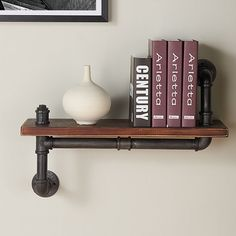 Hang Industrial Wood Floating Wall Shelf single tier, together or any combination to create a wall of storage and display. Each modern wall shelf is hand crafted of walnut wood. Brackets are hand forged metal in silver finish for a rustic look.