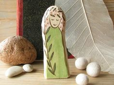 "ROSEMARY FAIRY - is hand-carved wooden toy, made by our tradition from white wood. It was inspired with the joy of summer and tender beauty of plants. Also with waldorf toys and decoration, nature table tradition and of course with my children and their reach fantasy world.  This wooden Daisy fairy measures cca 4.35"" x 1.8"" x 0,75"" (10,5 x 4 x1,9cm)."