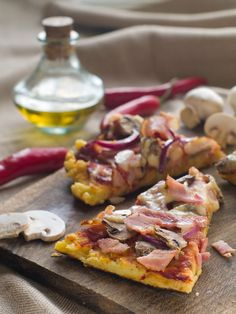#pizza #barbeque #grilling Grilled bacon and mushroom pizza makes a delicious meal. Pizza crust is topped with tomato sauce, mozzarella, bacon, mushrooms, oregano, gar...